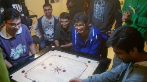 Students playing Carom