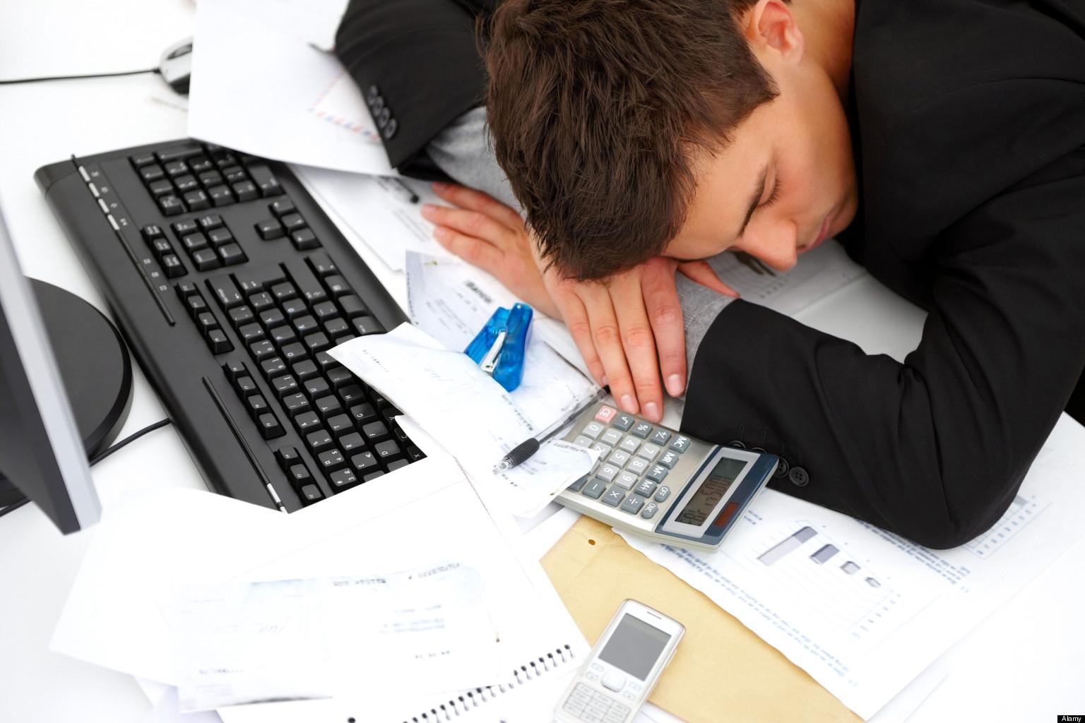 young man sleeping at desk